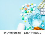 pills and glass of water on... | Shutterstock . vector #1364490032