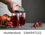 male hand pouring pomegranate... | Shutterstock . vector #1364547122