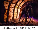 miner working a jackhammer in a ... | Shutterstock . vector #1364549162