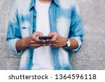 man holding a smartphone. using ... | Shutterstock . vector #1364596118