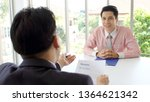 asian man in job interview at... | Shutterstock . vector #1364621342