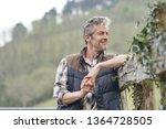 attractive farmer smiling...   Shutterstock . vector #1364728505