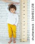 child measures height  | Shutterstock . vector #1364811158