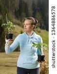 woman gardener watching her... | Shutterstock . vector #1364886578