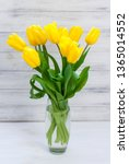 bouquet of yellow tulips in a... | Shutterstock . vector #1365014552