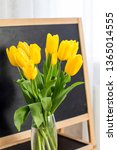 a bouquet of yellow tulips on a ... | Shutterstock . vector #1365014555