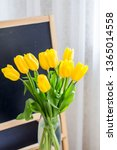a bouquet of yellow tulips on a ... | Shutterstock . vector #1365014558