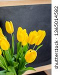 a bouquet of yellow tulips on a ... | Shutterstock . vector #1365014582