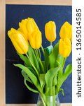 a bouquet of yellow tulips on a ... | Shutterstock . vector #1365014585
