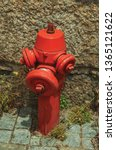 Close Up Of Red Hydrant Next To ...