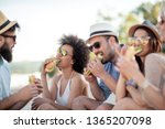 group of young people eating... | Shutterstock . vector #1365207098