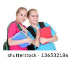 two young girls with textbooks... | Shutterstock . vector #136532186
