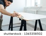 a man with a brush in his hand... | Shutterstock . vector #1365358502