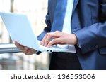 closeup of businessman typing... | Shutterstock . vector #136553006