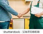 repairman and customer shake... | Shutterstock . vector #1365538838
