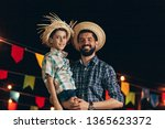 brazilian man and son wearing... | Shutterstock . vector #1365623372