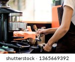 hands of young woman barista... | Shutterstock . vector #1365669392