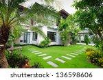 modern house in the garden | Shutterstock . vector #136598606