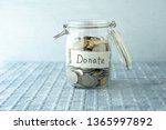coins in glass money jar with... | Shutterstock . vector #1365997892