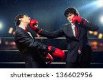 two young businessman boxing... | Shutterstock . vector #136602956