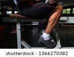 muscular man exercising calves... | Shutterstock . vector #1366270382