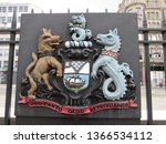 """Small photo of Belfast, Ireland: Aug 2018 - The exterior of Belfast City Hall, Donegall Square, Northern Ireland with Coat of Arms, What shall we give in return for so much"""""""