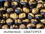 fried chestnuts on street.... | Shutterstock . vector #1366715915