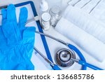 Stethoscope with different pharmaceutical stuff - stock photo