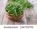 fresh arugula in the wooden... | Shutterstock . vector #136733792