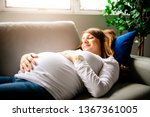 a happy pregnant woman lying on ... | Shutterstock . vector #1367361005
