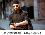 serious bearded man dressed in... | Shutterstock . vector #1367465735
