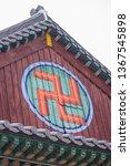Small photo of Buddhist swastika symbol on temple building - Haeinsa Temple UNESCO World Heritage List - South Korea