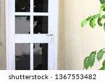 white door with black glasses ... | Shutterstock . vector #1367553482