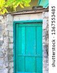 turquoise wooden door and a... | Shutterstock . vector #1367553485