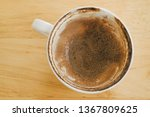 Small photo of Coffee cup over wooden background. Dregs in the bottom of the cup, with stains.