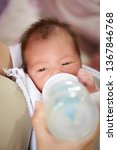 newborn baby drinking milk from ... | Shutterstock . vector #1367846768