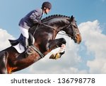 Stock photo rider on bay horse in jumping show 136798778