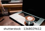 a cup of coffee with laptop on... | Shutterstock . vector #1368029612