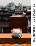 a cup of coffee and city view. | Shutterstock . vector #1368033482