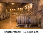 wine barrels stacked in the old ... | Shutterstock . vector #136806125