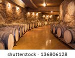 wine barrels stacked in the old ... | Shutterstock . vector #136806128