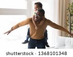 happy african father... | Shutterstock . vector #1368101348