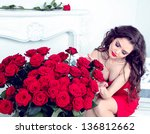 Stock photo sexy brunette woman with bouquet of red roses in modern interior apartment 136812662