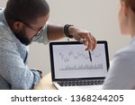 focused african analyst showing ... | Shutterstock . vector #1368244205