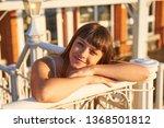 cute woman enjoys sunset light  ... | Shutterstock . vector #1368501812