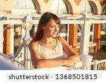 cute woman enjoys sunset light  ... | Shutterstock . vector #1368501815