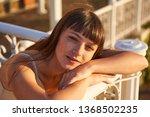 cute woman enjoys sunset light  ... | Shutterstock . vector #1368502235