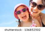 little girl and her mother have ... | Shutterstock . vector #136852502