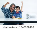 excited father or grandfather... | Shutterstock . vector #1368530438