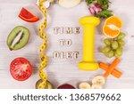 dumbbell  tape measure and... | Shutterstock . vector #1368579662